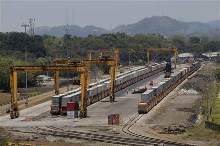 A Panama Canal railway train carrying containers is seen on the train tracks near the Pacific port in Panama City March 22, 2013. REUTERS/ Stringer