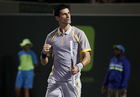 Serbia's Novak Djokovic gestures just after match point, having defeated Lukas Rosol of the Czech Republic in their men's singles second round match at the Sony Open tennis tournament in Key Biscayne, Florida March 22, 2013. REUTERS/Andrew Innerarity