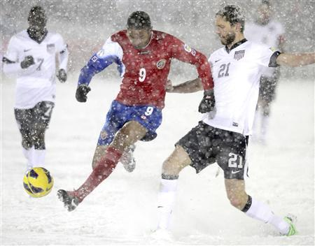 Costa Rica's Alvaro Saborio (L) takes the ball from Clarence Goodson of the U.S. during their 2014 World Cup qualifying soccer match in Commerce City, Colorado March 22, 2013. REUTERS/Mark Leffingwell