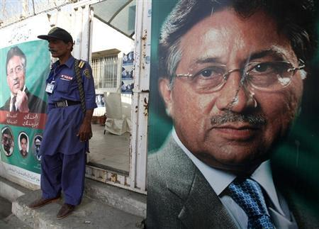 A security man stands guard at the entrance of former president Pervez Musharraf's campaign office, decorated with posters in Karachi March 21, 2013. REUTERS/Athar Hussain