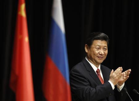 Chinese President Xi Jinping claps during his address to students at the Moscow State Institute of International Relations in Moscow March 23, 2013. REUTERS/Sergei Karpukhin