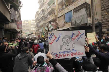 A girl holds a banner during a protest against Syria's President Bashar al-Assad in Bustan al-Qasr district in Aleppo, March 22, 2013. REUTERS/Giath Taha