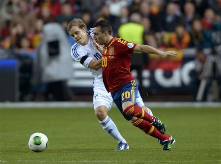 Finland's Teemu Pukki challenges Spain's Santiago Cazorla Gonzalez during their 2014 World Cup qualifying match at Molinon Stadium in Gijon, Spain, March 22, 2013. REUTERS/Vincent West
