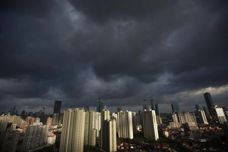 Dark clouds cover the sky in downtown Shanghai, August 6, 2012. REUTERS/Aly Song