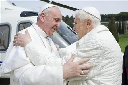 Pope Francis (L) embraces Pope Emeritus Benedict XVI as he arrives at the Castel Gandolfo summer residence March 23, 2013. Pope Francis travelled by helicopter from the Vatican to Castel Gandolfo for a private meeting with former Pope Benedict XVI. REUTERS/Osservatore Romano