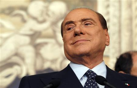Former Italian Prime Minister Silvio Berlusconi looks on as he speaks after meeting with Italian President Giorgio Napolitano at Quirinale palace in Rome March 21, 2013. REUTERS/Alessandro Bianchi