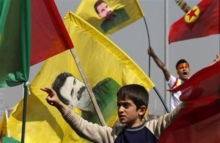 Demonstrators hold Kurdish flags and flags with portraits of jailed Kurdistan Workers Party (PKK) leader Abdullah Ocalan during a gathering to celebrate Newroz in the southeastern Turkish city of Diyarbakir March 21, 2013. REUTERS/Umit Bektas