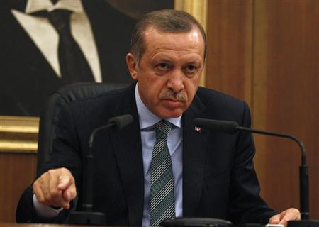 Turkey's Prime Minister Recep Tayyip Erdogan addresses the media before his flight to Denmark for an official visit at Esenboga Airport in Ankara March 19, 2013. REUTERS/Umit Bektas