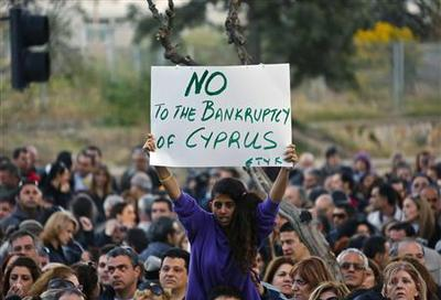 Cyprus weighs big bank levy; bailout goes down to wire