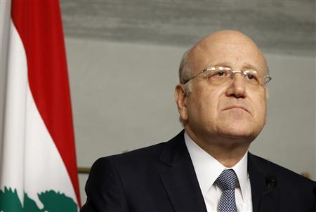 Lebanon's Prime Minister Najib Mikati speaks during a news conference at the Grand Serail, the government headquarters in Beirut, March 22, 2013. REUTERS/Mohamed Azakir