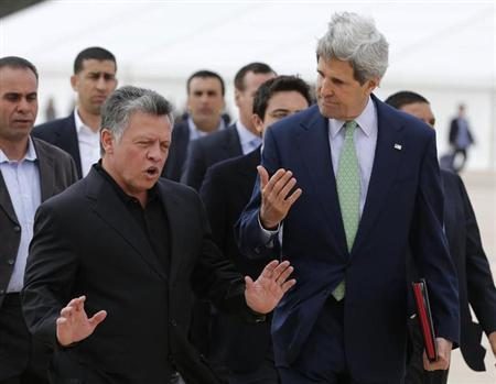 U.S. Secretary of State John Kerry (R) talks with Jordan's King Abdullah at the airport in Amman March 23, 2013. REUTERS/Larry Downing