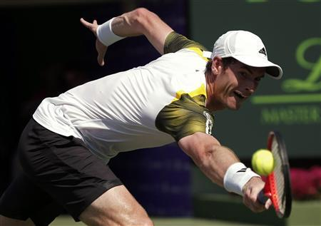 Andy Murray of Britain lunges for a return to Bernard Tomic of Australia during their Sony Open tennis tournament match in Key Biscayne, Florida March 23, 2013. REUTERS/Kevin Lamarque
