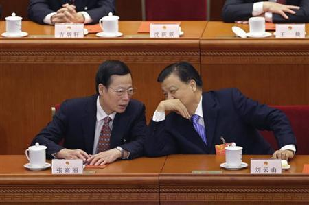 China's Politburo Standing Committee member Liu Yunshan (R) talks to newly-elected Vice-Premier Zhang Gaoli during the sixth plenary meeting of the National People's Congress (NPC) at the Great Hall of the People in Beijing, March 16, 2013. REUTERS/Jason Lee