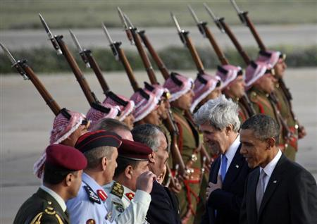 U.S. President Barack Obama (R) and U.S. Secretary of State John Kerry (2nd R) are greeted by Jordanian officials upon their arrival at Amman airport March 22, 2013. REUTERS/Ali Jarekji