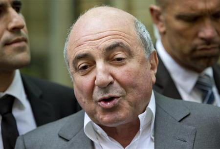 Russian oligarch Boris Berezovsky speaks to members of the media after losing his court battle against Roman Abramovich, at a division of the High Court in London August 31, 2012. REUTERS/Neil Hall