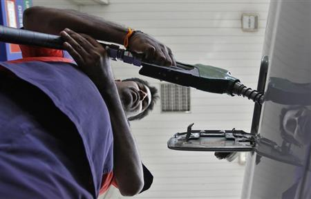 A worker fills diesel in a vehicle at a fuel station in the southern Indian city of Chennai January 18, 2013. REUTERS/Babu/Files