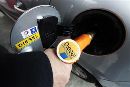 A customer fills-up his car with diesel at a gas station in Nice March 4, 2013. REUTERS/Eric Gaillard
