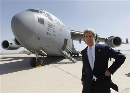 U.S. Secretary of State John Kerry arrives in Baghdad March 24, 2013. Kerry made an unannounced visit to Iraq on Sunday and will urge al-Maliki to make sure Iranian flights over Iraq do not carry arms and fighters to Syria, a U.S. official said. REUTERS/Jason Reed