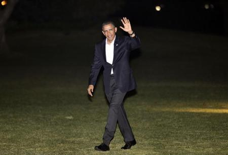 U.S. President Barack Obama waves as he walks on the South Lawn of the White House upon his return to Washington after a trip to Israel, March 23, 2013. REUTERS/Yuri Gripas