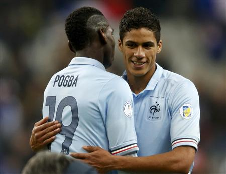 France's Paul Pogba and Raphael Varane congratulate each other after defeating Georgia in their 2014 World Cup qualifying match at the Stade de France stadium in Saint-Denis, near Paris, March 22, 2013. REUTERS/Charles Platiau