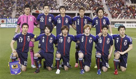 Japan's players pose for a group picture before their international friendly soccer match against Canada in Doha March 22, 2013. REUTERS/Mohammed Dabbous