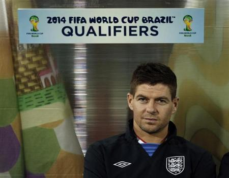 England's Steven Gerrard sits on the bench before their 2014 World Cup qualifying soccer match against San Marino at the Serravalle Stadium in San Marino March 22, 2013. REUTERS/Eddie Keogh