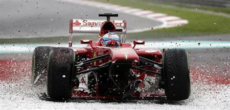 Ferrari Formula One driver Fernando Alonso of Spain drives onto the gravel after losing his front wing during the Malaysian F1 Grand Prix at Sepang International Circuit outside Kuala Lumpur, March 24, 2013. Alonso retired at the beginning of the second lap after losing his front wing. REUTERS/Tim Chong