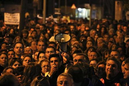 Thousands of bank employees protest outside the parliament in Nicosia March 23, 2013. Cyprus said on Saturday it would tax big savers at its largest bank in a dramatic U-turn as it raced to satisfy European partners and seal an 11th-hour bailout deal to avert financial collapse. REUTERS/Yannis Behrakis