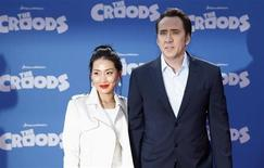 "Cast member Nicolas Cage and wife Alice Kim (L) arrive for the premiere of the film ""The Croods"" in New York, March 10, 2013. REUTERS/Carlo Allegri"
