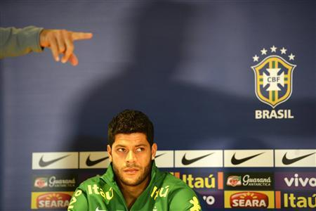 Brazil's football player Hulk listens to questions during a news conference ahead of a friendly soccer match against Brazil at Stamford Bridge stadium in west London March 24, 2013. REUTERS/Paul Hackett
