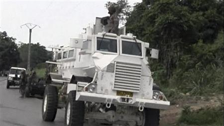 A South African soldier stands on top of a armoured vehicle in Begoua, 17 km (10 miles) from capital Bangui, in this still image take from video, March 23, 2013. Rebels in Central African Republic seized control of the riverside capital Bangui after fierce fighting on Sunday, forcing President Francois Bozize to flee and raising fears of instability in the mineral-rich heart of Africa. REUTERS/Reuters TV