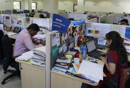 Employees of Tata Consultancy Services (TCS) work inside the company headquarters in Mumbai March 14, 2013. REUTERS/Danish Siddiqui