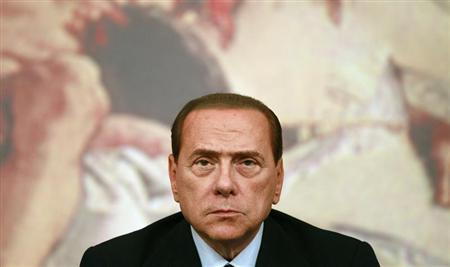 Former Italian prime minister Silvio Berlusconi looks on during a news conference at Chigi Palace in Rome August 4, 2011. REUTERS/Tony Gentile