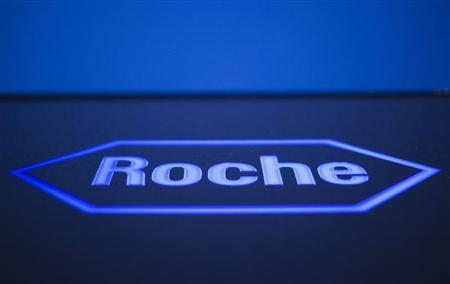 A logo of Swiss pharmaceutical company Roche is pictured in front of a company's building in Rotkreuz, April 12, 2012. REUTERS/Michael Buholzer