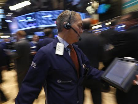 Traders work on the floor at the New York Stock Exchange, March 21, 2013. REUTERS/Brendan McDermid