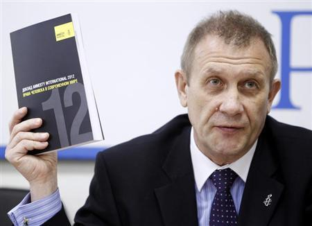 Sergei Nikitin, Director of Amnesty International Representative Office in Russia, speaks during a news conference in Moscow, May 23, 2012. Picture taken May 23, 2012. REUTERS/Denis Sinyakov