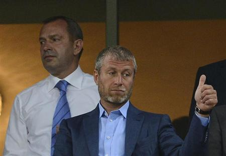 Russian billionaire and owner of Chelsea football club Roman Abramovich gives a thumbs-up before the Group D Euro 2012 soccer match between Ukraine and England at Donbass Arena in Donetsk June 19, 2012. REUTERS/Nigel Roddis