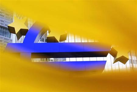 A structure of the Euro currency sign is seen through a sunflower in front of the European Central Bank (ECB) headquarters in Frankfurt July 11, 2012. REUTERS/Alex Domanski