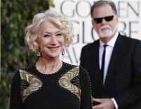 Actress Helen Mirren and director Taylor Hackford arrive at the 70th annual Golden Globe Awards in Beverly Hills, California, January 13, 2013. REUTERS/Mario Anzuoni