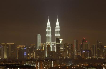 The Petronas Twin Towers in Kuala Lumpur, a Malaysian landmark, are pictured after lights were turned on after the Earth Hour March 31, 2012. REUTERS/Bazuki Muhammad