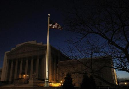 The United States Supreme Court is seen before dawn in Washington March 22, 2013. REUTERS/Gary Cameron