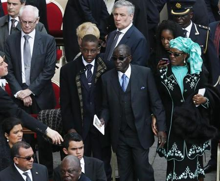 Zimbabwe's President Robert Mugabe (C) and his wife Grace pass European Council President Herman Van Rompuy (L) during the inaugural mass of Pope Francis at the Vatican, March 19, 2013. REUTERS/Stefano Rellandini