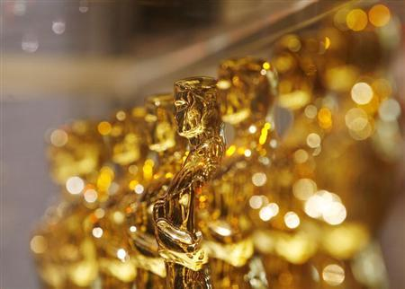 A line of Oscar statuettes can be seen at a ''Meet The Oscars'' display in Times Square, New York February 15, 2008. REUTERS/Lucas Jackson