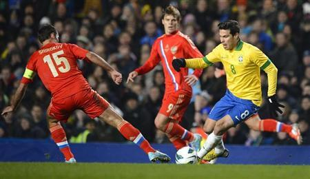 Fred of Brazil (R) and Roman Shirokov of Russia fight for the ball during their friendly international soccer match at Stamford Bridge in London, March 25, 2013. REUTERS/Paul Hackett