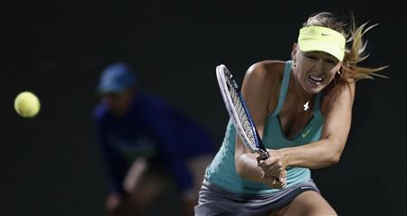 Russia's Maria Sharapova returns a shot to the Czech Republic's Klara Zakopalova in their women's singles fourth round match at the Sony Open tennis tournament in Key Biscayne, Florida March 25, 2013. REUTERS/Andrew Innerarity
