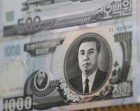 North Korean bank note are seen at a pavilion, just south of the border between the two Koreas, in Paju, north of Seoul, February 15, 2013. REUTERS/Lee Jae-Won