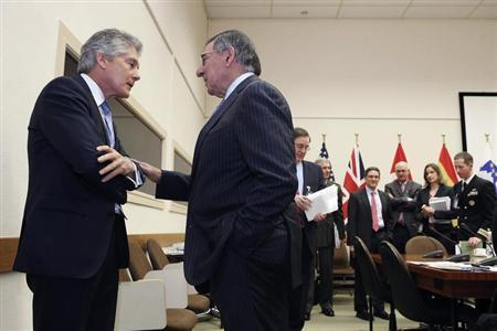 U.S. Defense Secretary Leon Panetta and Australian Defence Minister Stephen Smith (L) meet during a North Atlantic Treaty Organization (NATO) defence ministers' meeting at the NATO headquarters in Brussels February 22, 2013. REUTERS/Chip Somodevilla/Pool