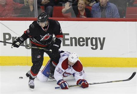 Carolina Hurricanes' Alexander Semin (L) battles Montreal Canadiens' Travis Moen for the puck during the third period of their NHL hockey game in Raleigh, North Carolina March 7, 2013. REUTERS/Ellen Ozier