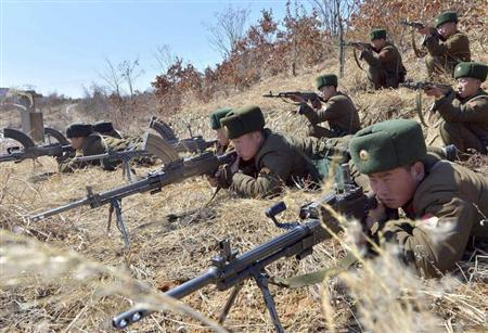 North Korean soldiers attend military drills in an unknown location in this picture taken March 20, 2013 and released by the North's official KCNA news agency March 21, 2013. REUTERS/KCNA