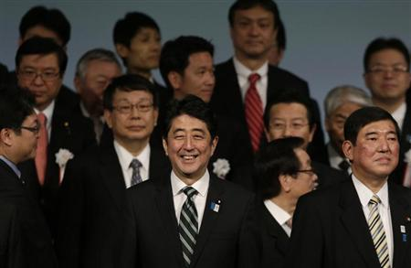 Japan's Prime Minister Shinzo Abe (front C) smiles during the ruling Liberal Democratic Party (LDP) annual convention in Tokyo March 17, 2013. REUTERS/Toru Hanai